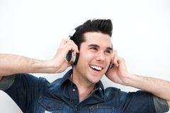 Portrait of a handsome young man listening to music on headphones Stock Images