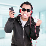 Portrait of a handsome young man listening to music Royalty Free Stock Images