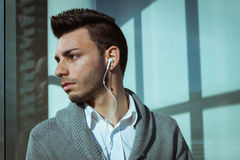 Portrait of a handsome young man listening to music Royalty Free Stock Photography
