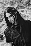 Portrait of a handsome young man with long hair. Black and white Royalty Free Stock Photo