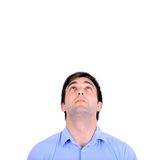 Portrait of handsome young man looking above isolated on white. This image is made in studio with model standing against white background.Set of various Royalty Free Stock Image