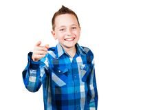Portrait of a handsome young man looking and pointing to the camera, isolated on a white background. Portrait of a handsome young man looking and pointing to the royalty free stock photography