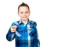 Portrait of a handsome young man looking and pointing to the camera, isolated on a white background. Portrait of a handsome young man looking and pointing to the stock photography