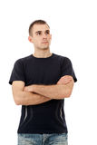Portrait of a handsome young man looking upwards Stock Photo