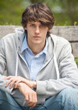 Portrait of handsome young man outdoors Stock Photos