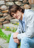 Portrait of handsome young man outdoors Stock Image