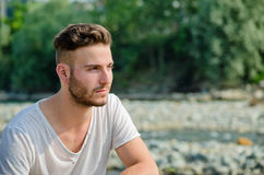 Portrait of handsome young man outdoors in nature Royalty Free Stock Photos