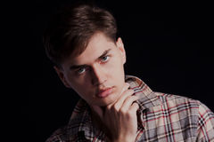 Portrait of a handsome young man in a plaid shirt Stock Image