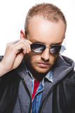 Portrait of handsome young man with reflection in sunglasses. And on a white background Royalty Free Stock Image