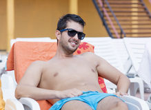 Portrait of handsome  young man relaxing on the beach Royalty Free Stock Photo