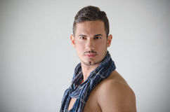 Portrait of handsome young man shirtless with blue scarf Stock Photo