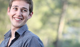 Portrait of a handsome young man smiling Stock Photography