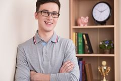 Portrait of handsome young man smiling indoor. royalty free stock photography