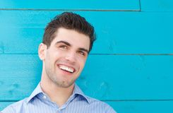 Portrait of a handsome young man smiling and looking away Stock Images