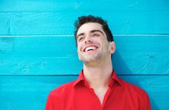 Portrait of a handsome young man smiling outdoors Royalty Free Stock Photos