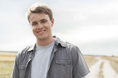 Portrait of handsome young man standing on field Royalty Free Stock Photos