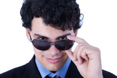 Portrait of a handsome young man with sun glasses Royalty Free Stock Photo