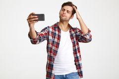 Portrait of a handsome young man taking a selfie Royalty Free Stock Photography