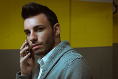 Portrait of a handsome young man talking on phone Stock Photography