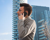 Portrait of a handsome young man talking on phone Royalty Free Stock Photo