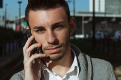 Portrait of a handsome young man talking on phone Stock Photo