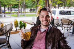 Portrait of handsome young man tasting a lager beer Stock Photography