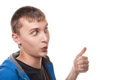 Portrait of a handsome young man, thumbs up Stock Photos