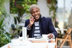Handsome young man using his mobile phone in the cafe. Portrait of handsome young man using his mobile phone in the cafe Royalty Free Stock Image