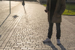 Portrait of handsome young man using his mobile phone in the street. Portrait of handsome young man using his mobile phone in the street in sanly day Royalty Free Stock Photos