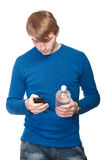 Portrait of a handsome young man with a water bottle over a white Stock Photos