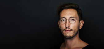 Portrait of handsome young man wearing glasses Royalty Free Stock Photo