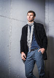 Portrait of handsome young man wearing jeans and coat Royalty Free Stock Images
