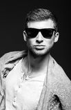 Portrait of handsome young man wearing sunglasses. Black and white Stock Images