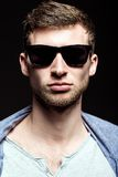 Portrait of handsome young man wearing sunglasses. Closeup Royalty Free Stock Photography