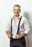 Portrait of handsome young man in white shirt and suspenders Royalty Free Stock Image