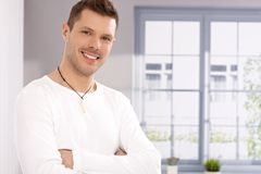 Portrait of handsome young man by window Stock Images