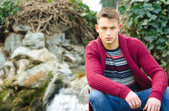 Portrait of handsome young man with winter clothes and blue jeans Stock Images