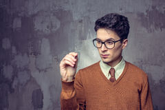 Portrait of a handsome young man writting something on a glass writeboard Stock Image