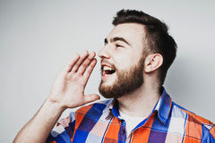 Portrait of a handsome young man yelling Royalty Free Stock Photo