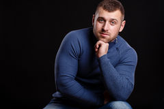 Portrait of handsome young muscular man on black background. Portrait of sexy macho man over dark background Royalty Free Stock Image