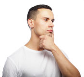 Portrait of handsome young thoughtful man isolated over white ba Stock Photography