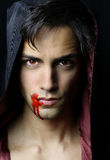Portrait of a handsome young vampire Stock Images