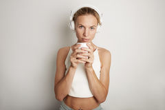 Portrait Handsome Young Woman Listening Music Player Headphones Blank White Background.Pretty Girl looking Holding Coffe Stock Image