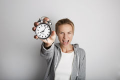 Portrait Handsome Young Woman Posing Blank White Background.Pretty Girl Screaming Holding Vintage Alarm Clock Hand Empty Stock Photography