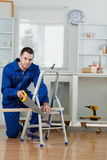 Portrait of a handyman cutting a wooden board Royalty Free Stock Photography