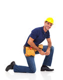Handyman kneeling Stock Photo