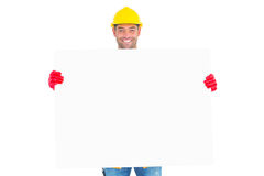 Portrait of handyman showing blank placard. On white background Stock Photography