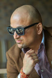 Portrait of a hansome indian businessman in sunglasses, serious and confident man Royalty Free Stock Image