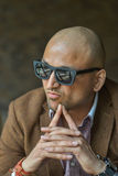 Portrait of a hansome indian businessman wearing sunglasses, serious and confident man looking at camera Stock Photos