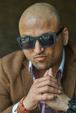 Portrait of a hansome indian businessman wearing sunglasses, serious and confident man looking at camera. Portrait of a hansome indian businessman wearing Stock Image